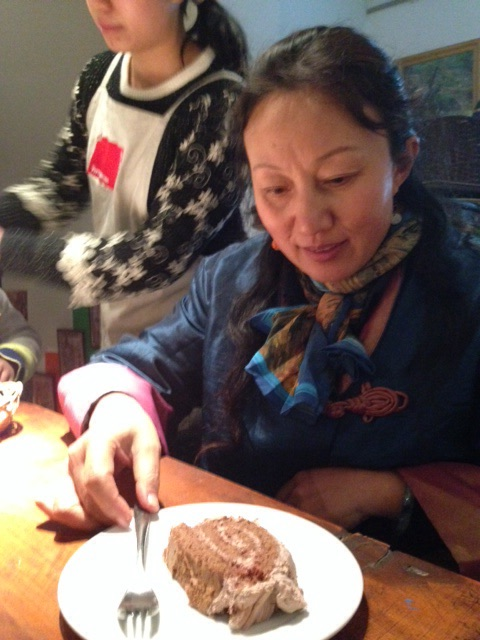 Chef's wife offering me yet another piece of Buche de Noel